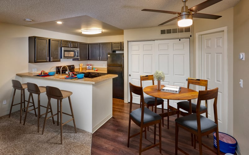 Renovated kitchen with stainless-steel appliances at Bluesky Landing Apartments in Lakewood, Colorado