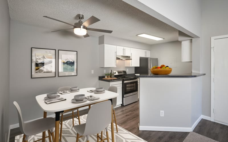 Renovated kitchen with white cabinets at Alton Green Apartments in Denver, Colorado