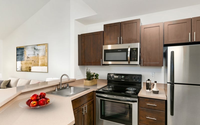 Renovated kitchen with stainless-steel appliances at Autumn Chase Apartments in Vancouver, Washington
