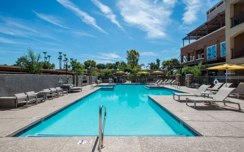 Sparkling swimming pool at Luxe Scottsdale Apartments in Scottsdale, Arizona