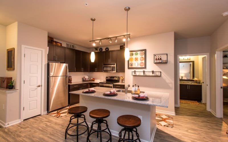 Kitchen area featuring stainless steel appliances at Luxe Scottsdale Apartments in Scottsdale, Arizona