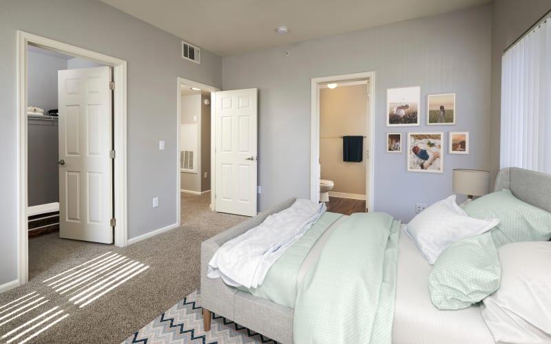 Spacious bedroom with plush carpeting at Westridge Apartments in Aurora, Colorado