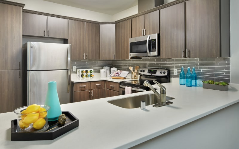Renovated kitchen with white cabinets at Brookside Village in Auburn, Washington