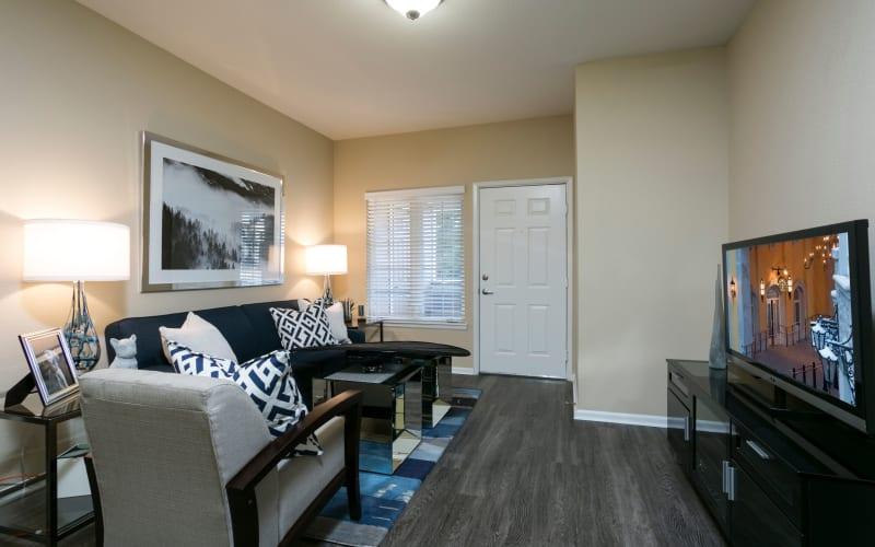 Spacious living room with wood flooring at Crestone Apartments in Aurora, Colorado
