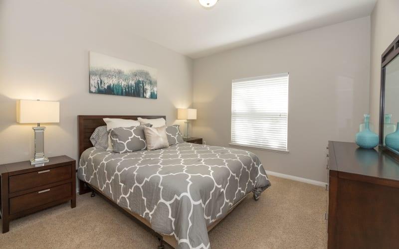 Spacious master bedroom with plush carpeting at Avion Apartments in Rancho Cordova, California