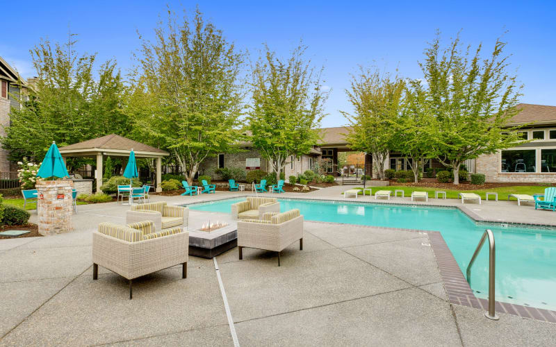 Fire pit lounge area poolside at The Grove at Orenco Station in Hillsboro, Oregon