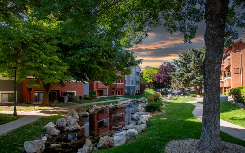 View of the brook and beautiful trees  at Shadowbrook Apartments in West Valley City, Utah