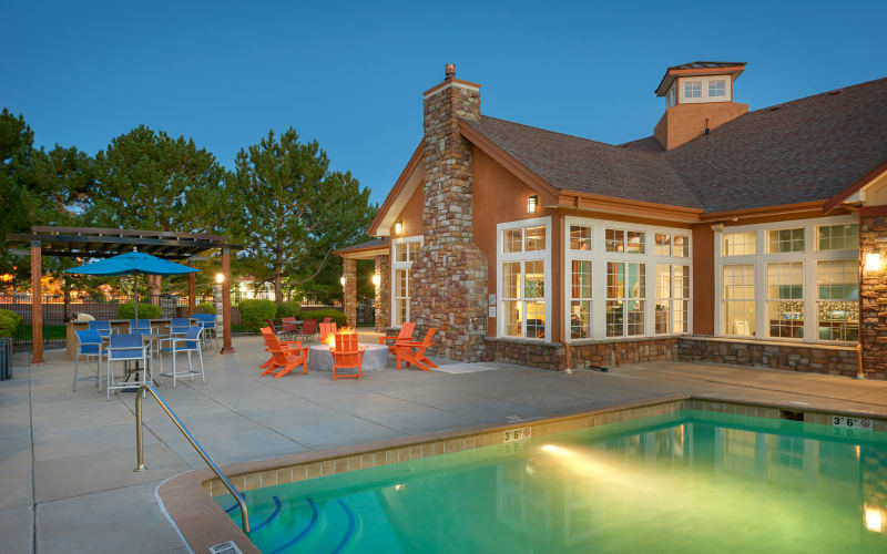 Fire pit lounge area poolside and pool at sunrise at Crestone Apartments in Aurora, Colorado