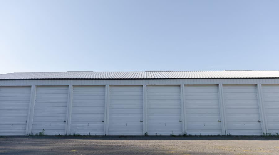 Storage units with white doors at KO Storage of Amery in Amery, Wisconsin