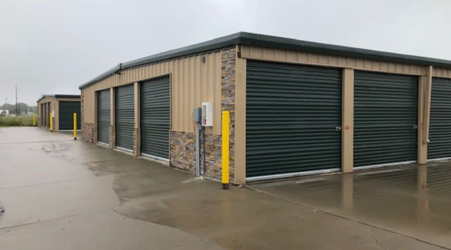 Storage units with green doors and locks at KO Storage of Vermillion in Vermillion, South Dakota