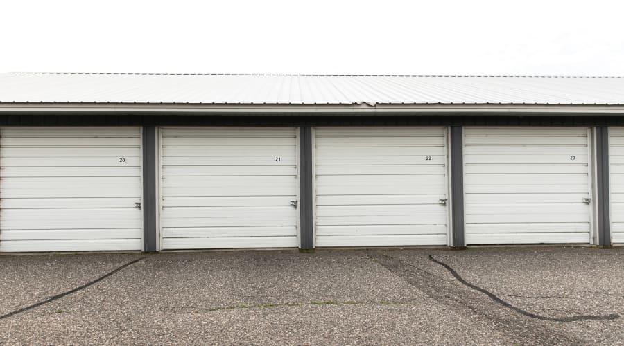Storage units with white doors at KO Storage of Maple Lake - Lumber in Maple Lake, Minnesota