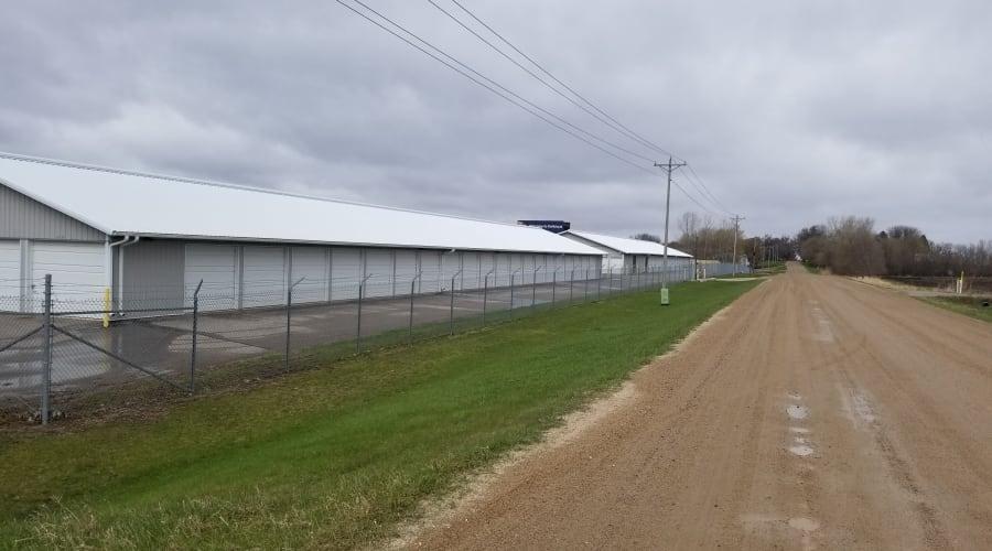 The fully fenced perimeter and storage units at KO Storage of Buffalo in Buffalo, Minnesota