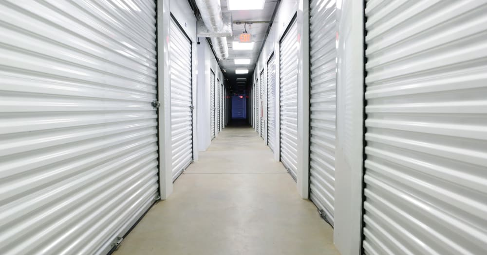 Storage units with white doors at Midgard Self Storage in Savannah, Georgia