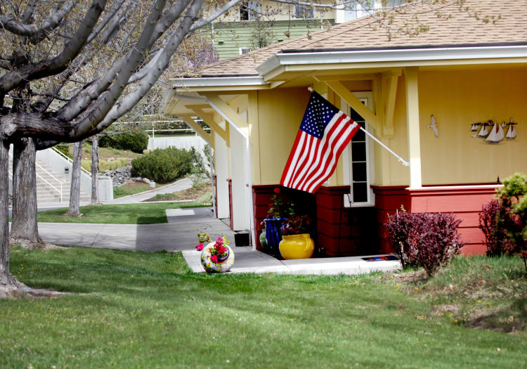 Front Door walkway, flag at Crystal Terrace of Klamath Falls in Klamath Falls, Oregon