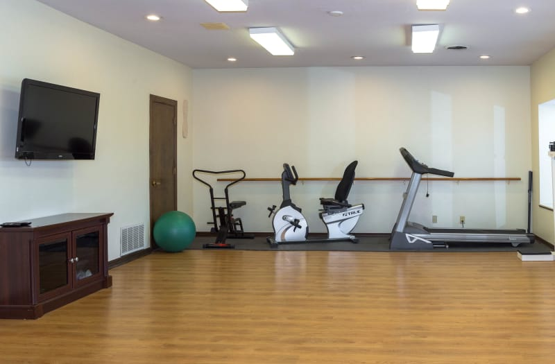 Gym area at Country Club At Woodland Hills in Tulsa