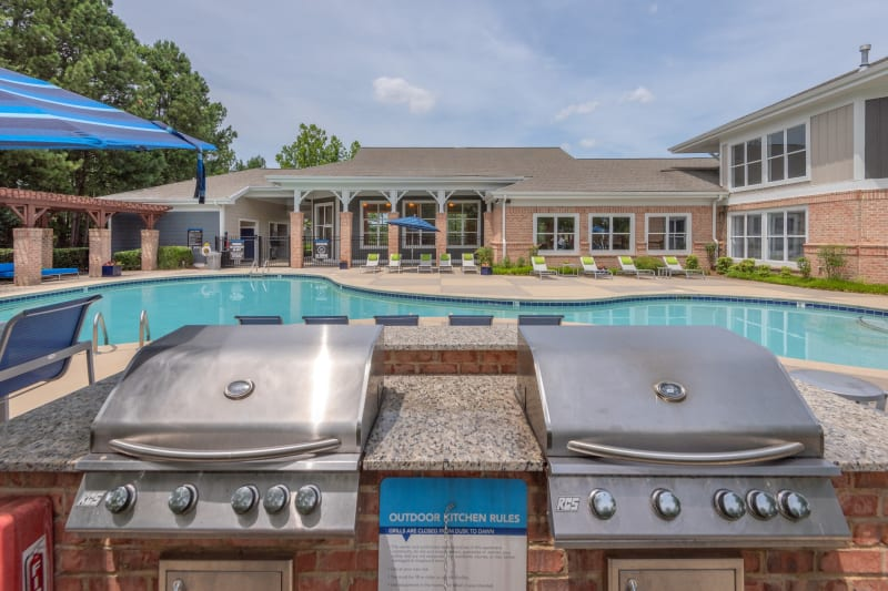 Barbecue area with gas grills overlooking the swimming pool at 200 East in Durham, North Carolina