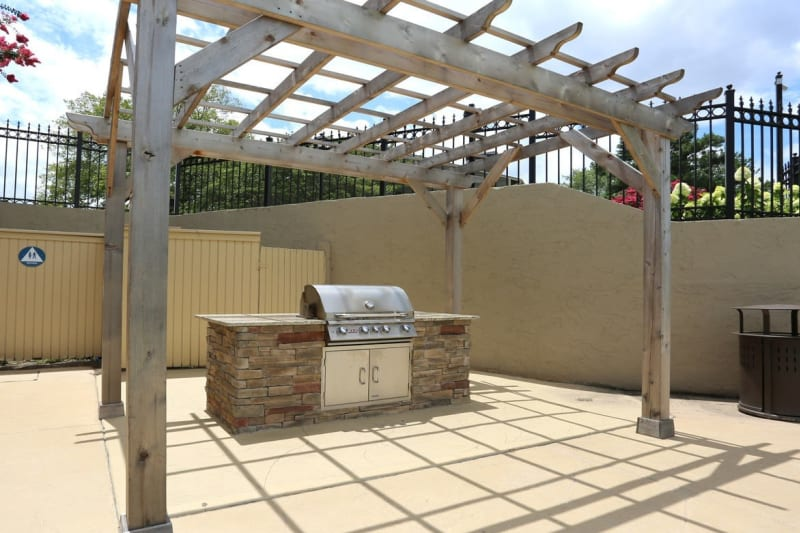 Pergola over the barbecue area with gas grills at The Everette at East Cobb in Marietta, Georgia