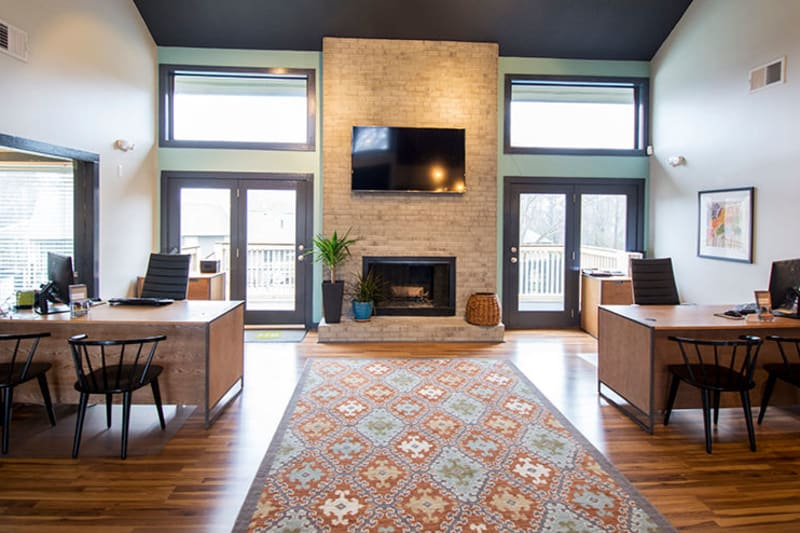 Lounge area with a fireplace in the clubhouse at The Everette at East Cobb in Marietta, Georgia