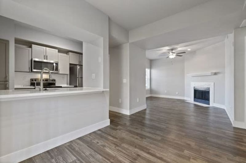 Living room and kitchen at Emerson at Ford Park in Allen, Texas