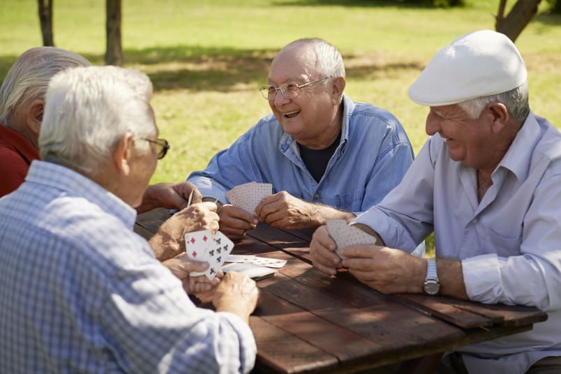 Residents playing cards at MuirWoods Memory Care in Petaluma