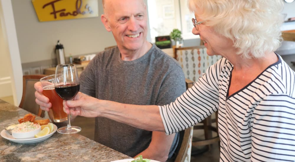 2 residents enjoying drinks with a meal at The Springs at Sherwood in Sherwood, Oregon