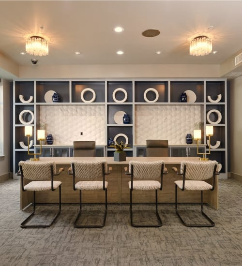 Resident common area with desks to work at or hang out at Seville Uptown in Dallas, Texas