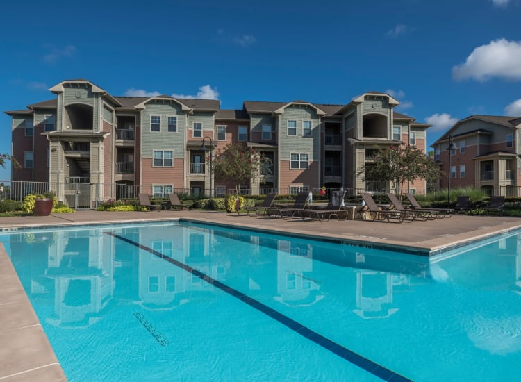 Our beautiful Cambria Cove Apartments in Houston, Texas showcase a swimming pool