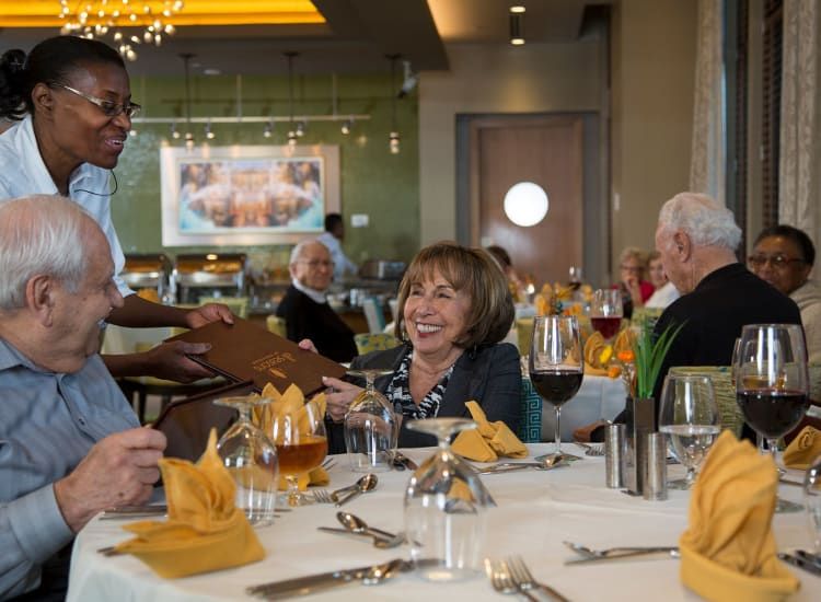 Residents ordering a restaurant-style meal in one of our dining areas at All Seasons Ann Arbor in Ann Arbor, Michigan