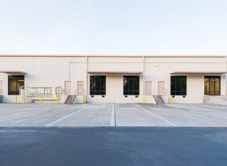 Loading docks and access lot in the back of Fort Family Investments's commercial property, Interstate South Commerce Center, in Jacksonville, Florida