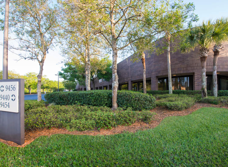 Trees and beautifully managed landscaping around Fort Family Investments's commercial property, Interstate South Commerce Center, in Jacksonville, Florida