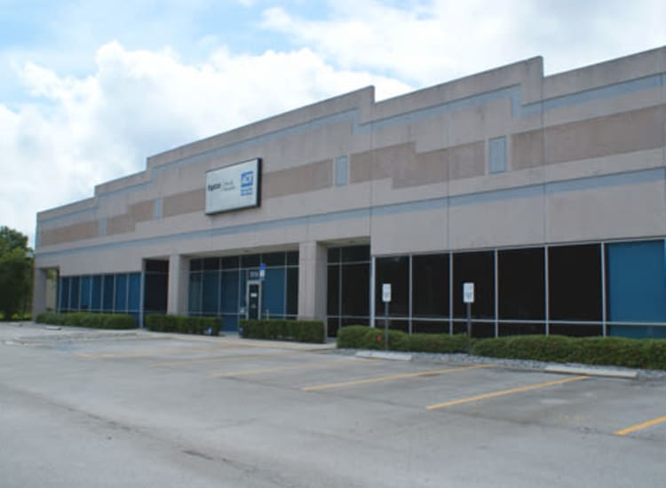 Well-maintained parking lot and building facade at Fort Family Investments's commercial property, Perimeter Commerce Park, in Jacksonville, Florida