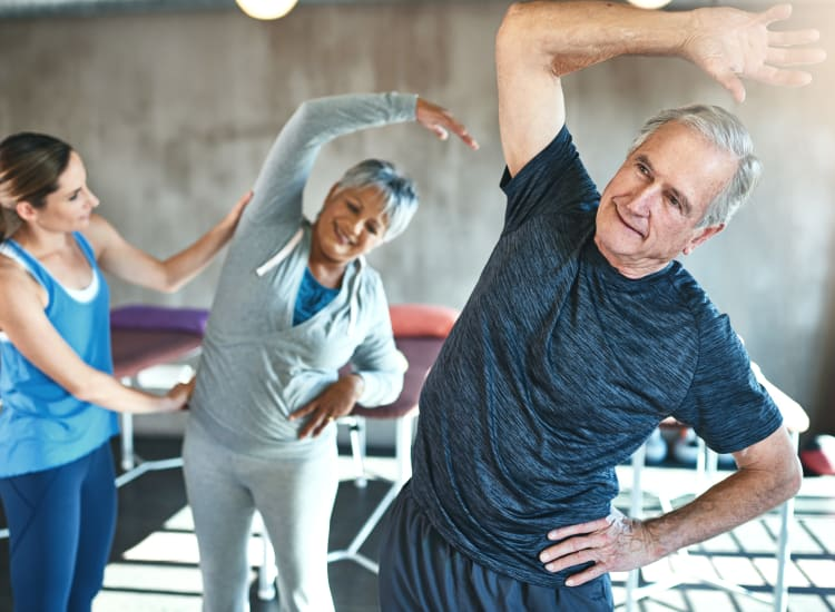 Residents staying fit in a yoga class at Bella Vista Senior Living in Mesa, Arizona