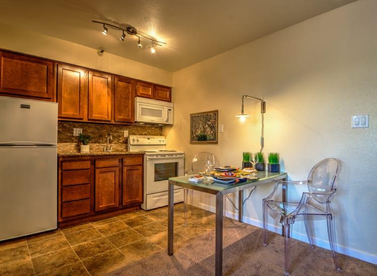 Cherry wood cabinetry and custom lighting in a model senior apartment at Bella Vista Senior Living in Mesa, Arizona