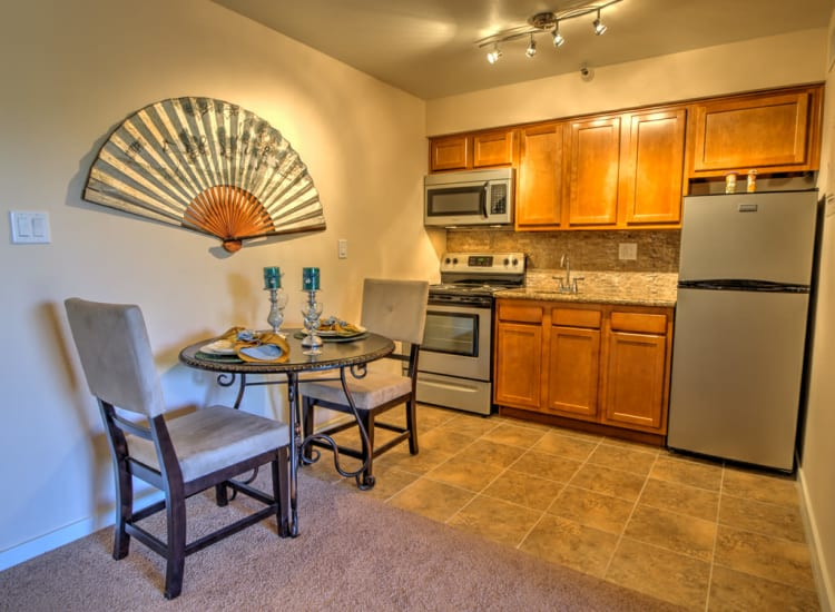 Modern kitchen with stainless-steel appliances in a model senior apartment at Bella Vista Senior Living in Mesa, Arizona
