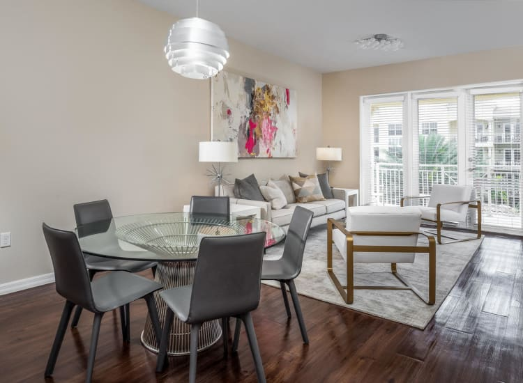 Hardwood floors in the dining and living areas in a model senior apartment at Riverwalk Pointe in Jupiter, Florida