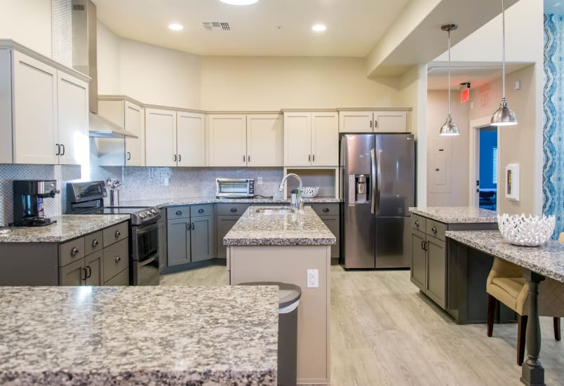 Modern kitchen with all the conveniences in model home at Hacienda Del Rey