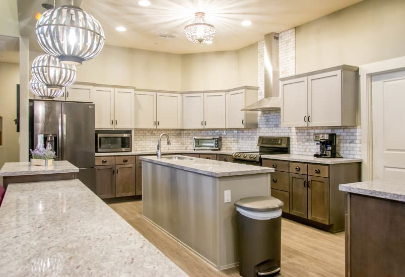 Fully-equipped kitchen in model home at Hacienda Del Rey