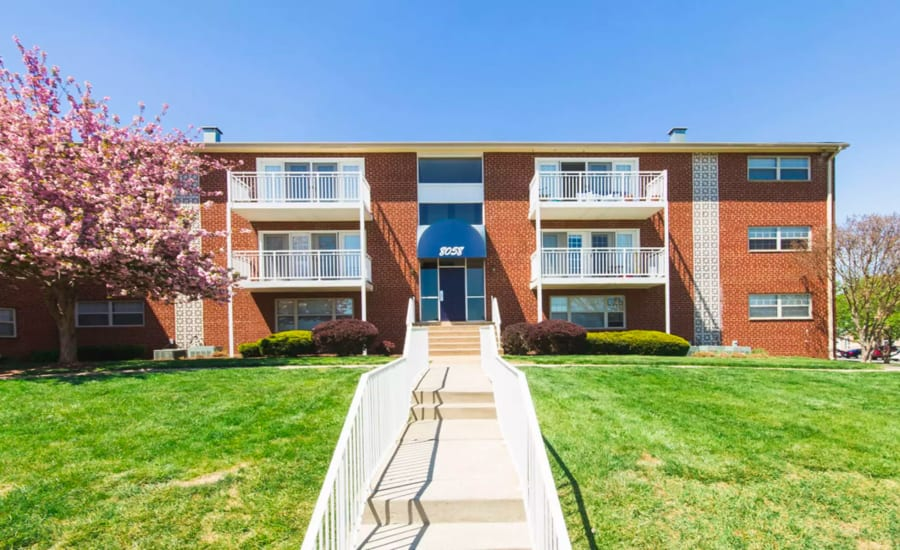 Exterior view of resident building and well-maintained landscaping at Westgate Apartments & Townhomes in Manassas, Virginia