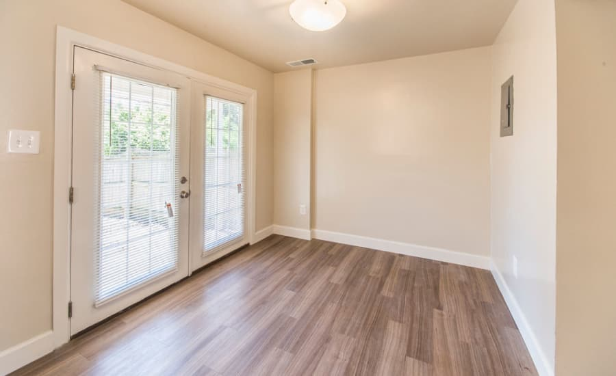 French doors and hardwood floors in model home at Westgate Apartments & Townhomes in Manassas, Virginia