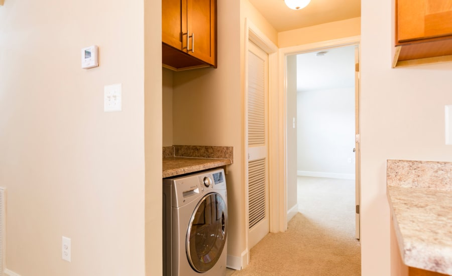 ln-unit washer and dryer in model home at Westgate Apartments & Townhomes in Manassas, Virginia