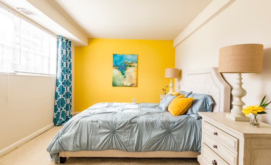 Master bedroom with accent wall in model home at Westgate Apartments & Townhomes in Manassas, Virginia
