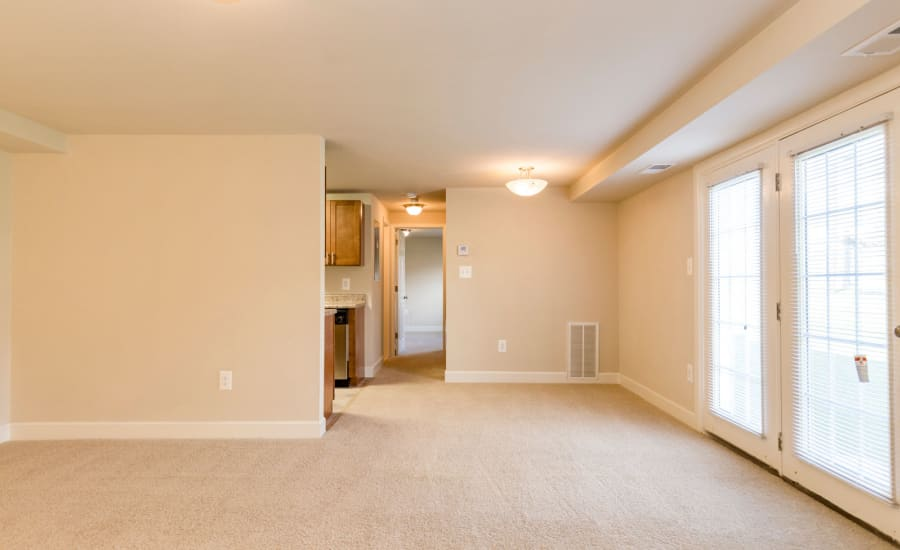 Plush carpet in living area of open-concept floor plan at Westgate Apartments & Townhomes in Manassas, Virginia