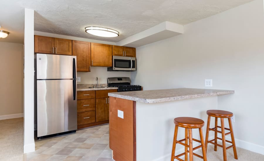 Breakfast bar with granite countertop in model home at Westgate Apartments & Townhomes in Manassas, Virginia