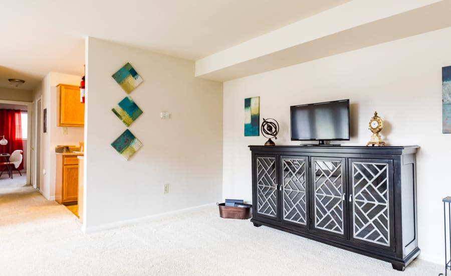 Well-decorated living area of model home at Westgate Apartments & Townhomes in Manassas, Virginia