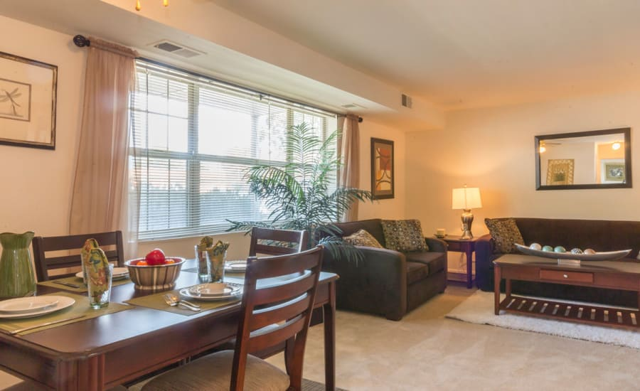 View of living area from dining nook in open-concept floor plan of model home at Westgate Apartments & Townhomes in Manassas, Virginia