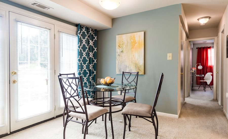 French doors leading out to private patio from dining nook in model home at Westgate Apartments & Townhomes in Manassas, Virginia