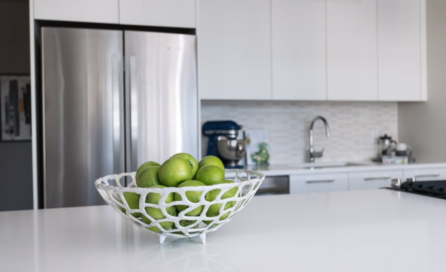 Bowl of limes in a Residences at 8 East Huron kitchen in Chicago, Illinois