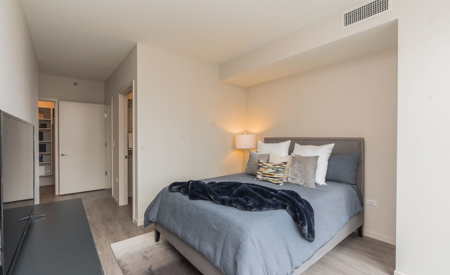 Cozy bedroom at Residences at 8 East Huron in Chicago, Illinois