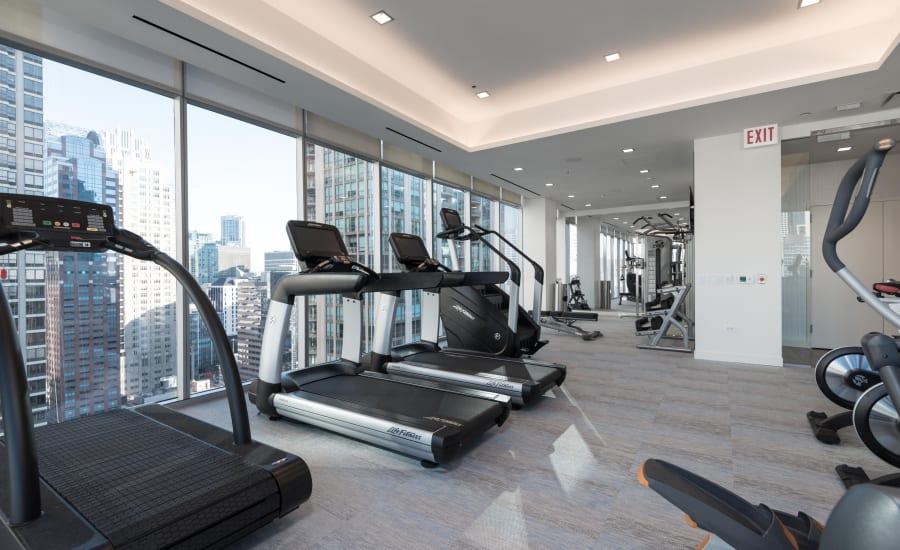 Fitness center for residents at Residences at 8 East Huron in Chicago, Illinois