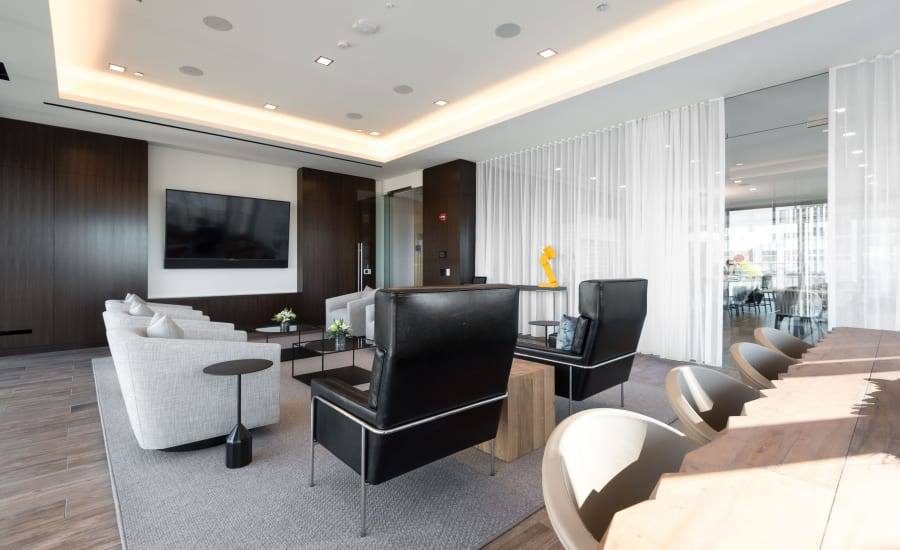 Community media room at Residences at 8 East Huron in Chicago, Illinois